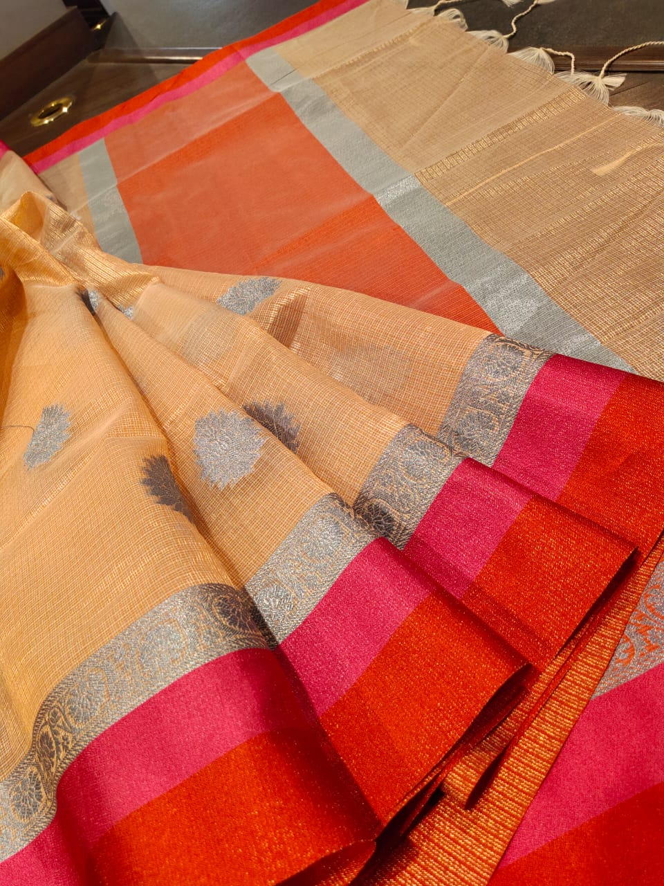 Light orange kota saree with silver,orange and pink border and silver booties all over