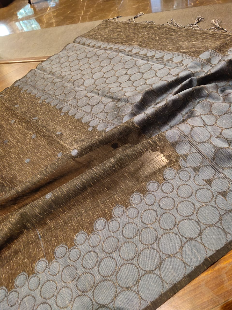 Greyish brown linen saree with silver weaving border and booties all over