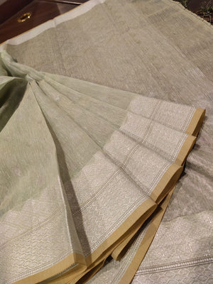 Light green linen saree with silver zari weaving and booties all over