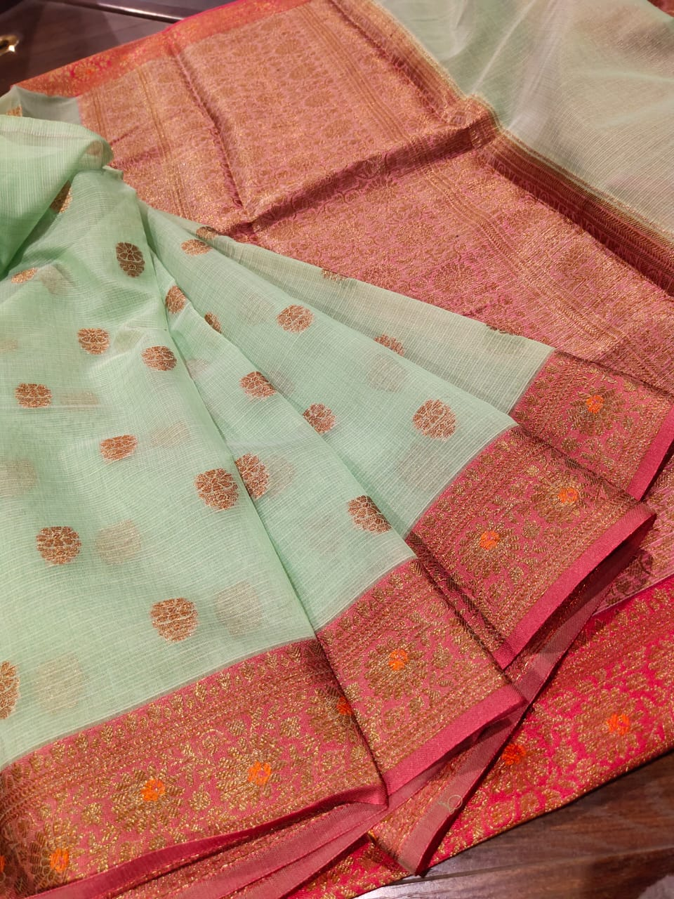 Light green linen saree with golden zari weaving and booties all over