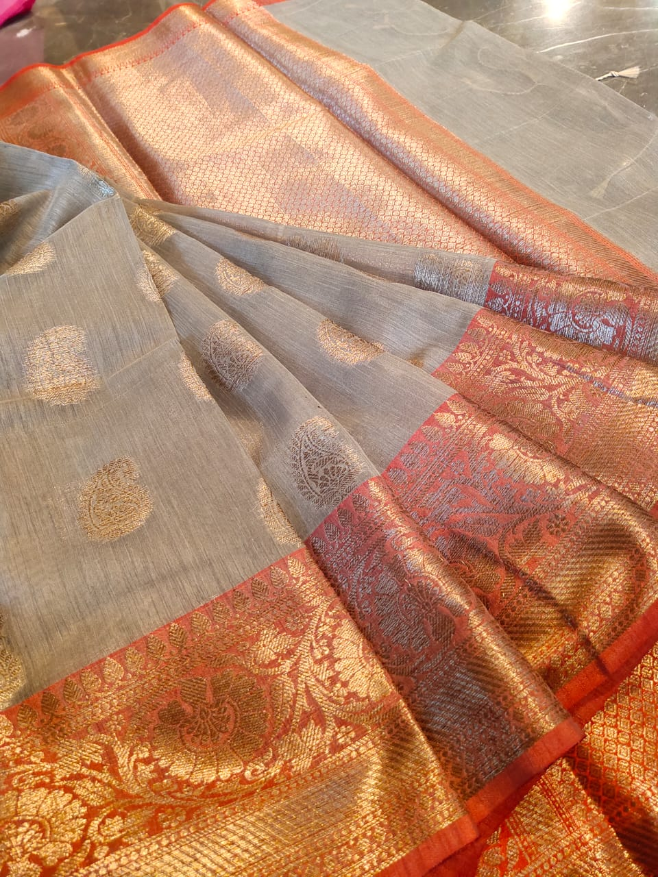 Light brown linen saree with golden zari weaving and booties all over
