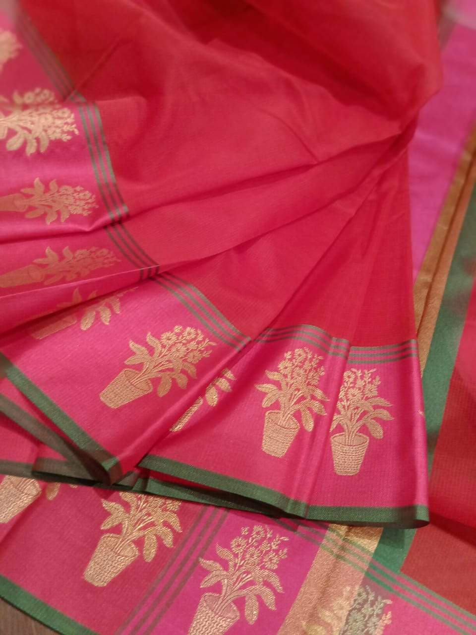 Red Chanderi saree with pink border with golden motifs on it