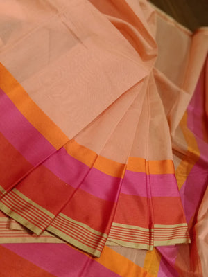 Light orange chanderi saree with orange and pink,red border