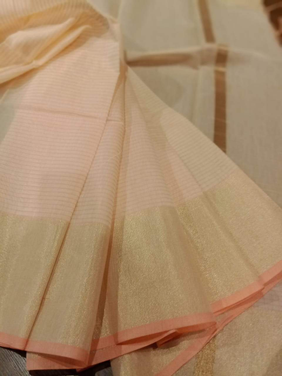 Cream chanderi saree with golden zari weaving and small peach border - EthnicRoom