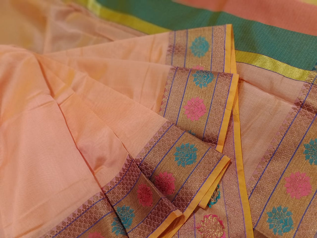 Light orange chanderi saree with golden zari weaving and Multicolor flowers on it