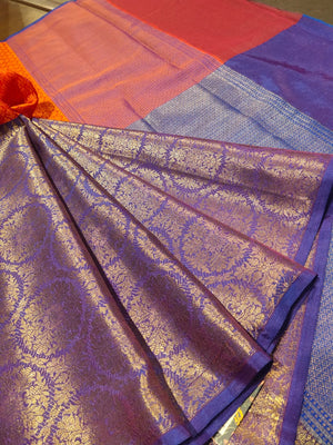 Horizontally divided into orange and blue tanchoi kora saree with golden weaving on blue - EthnicRoom