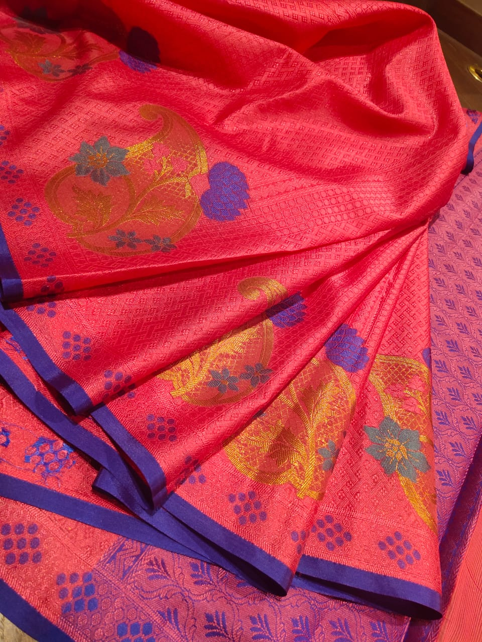 Pink tanchoi kora saree with Multicolor motifs and small blue border