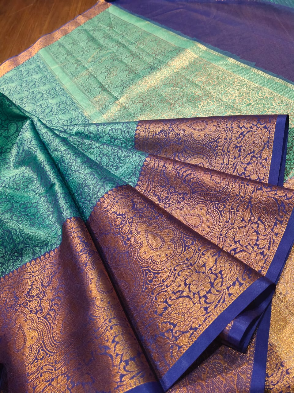 Sea green tanchoi kora saree with golden zari weaving