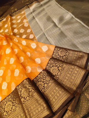 Orange kora saree with golden zari weaving and silver booties all over
