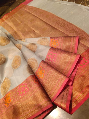 Light grey kora saree with golden booties all over and Multicolor flowers on zari