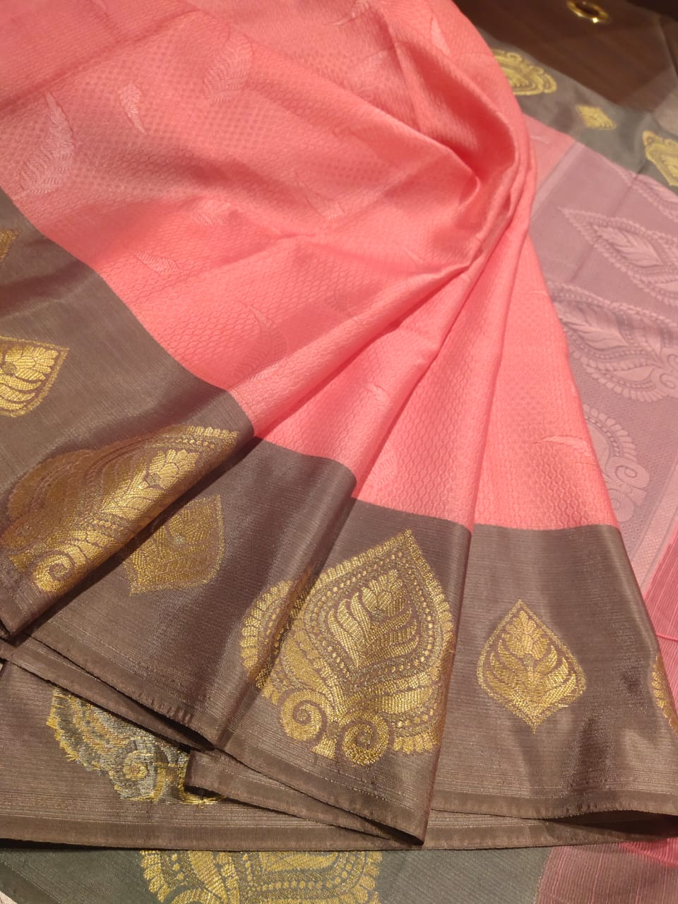 Pink tanchoi kora saree with folden motifs on grey border