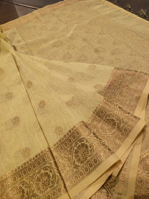 Lemon yellow linen saree with golden zari weaving and booties all over