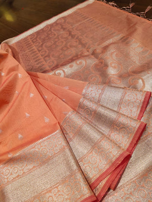 Light peach chanderi saree with silver zari weaving and booties all over