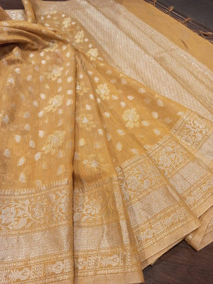 Mustard yellow linen saree with silver zari weaving and booties all over