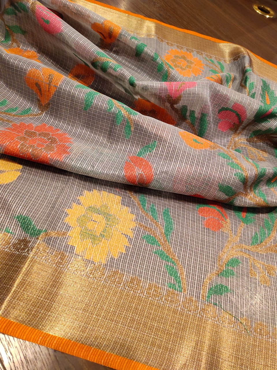 Grey kota saree with golden zari weaving and Multicolor flowers all over