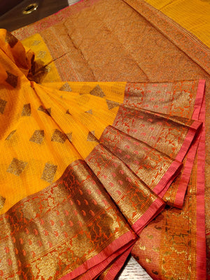 Yellow kota saree with golden zari weaving and booties all over