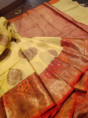 Yellow kota saree with golden zari weaving on red border and golden booties all over