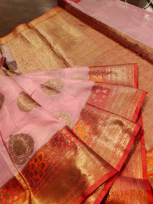Light pink kota saree with golden zari weaving and booties all over