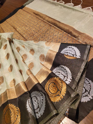 Light green kota saree with golden silver and golden motifs on black border and golden booties all over