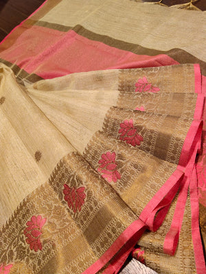 Cream kota saree with golden zari weaving with pink flowers and golden booties all over