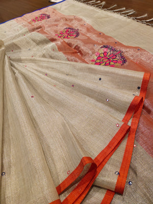 Silver zari linen saree with multi colour border and mirror work embroidery