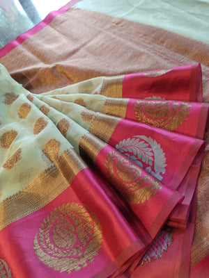 Light green kora saree with combination of golden and silver booties in pink border