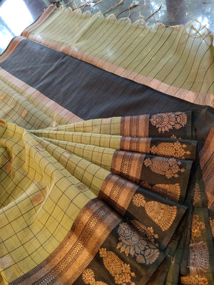 Light olive green kora saree with black checks all over and golden zari booties