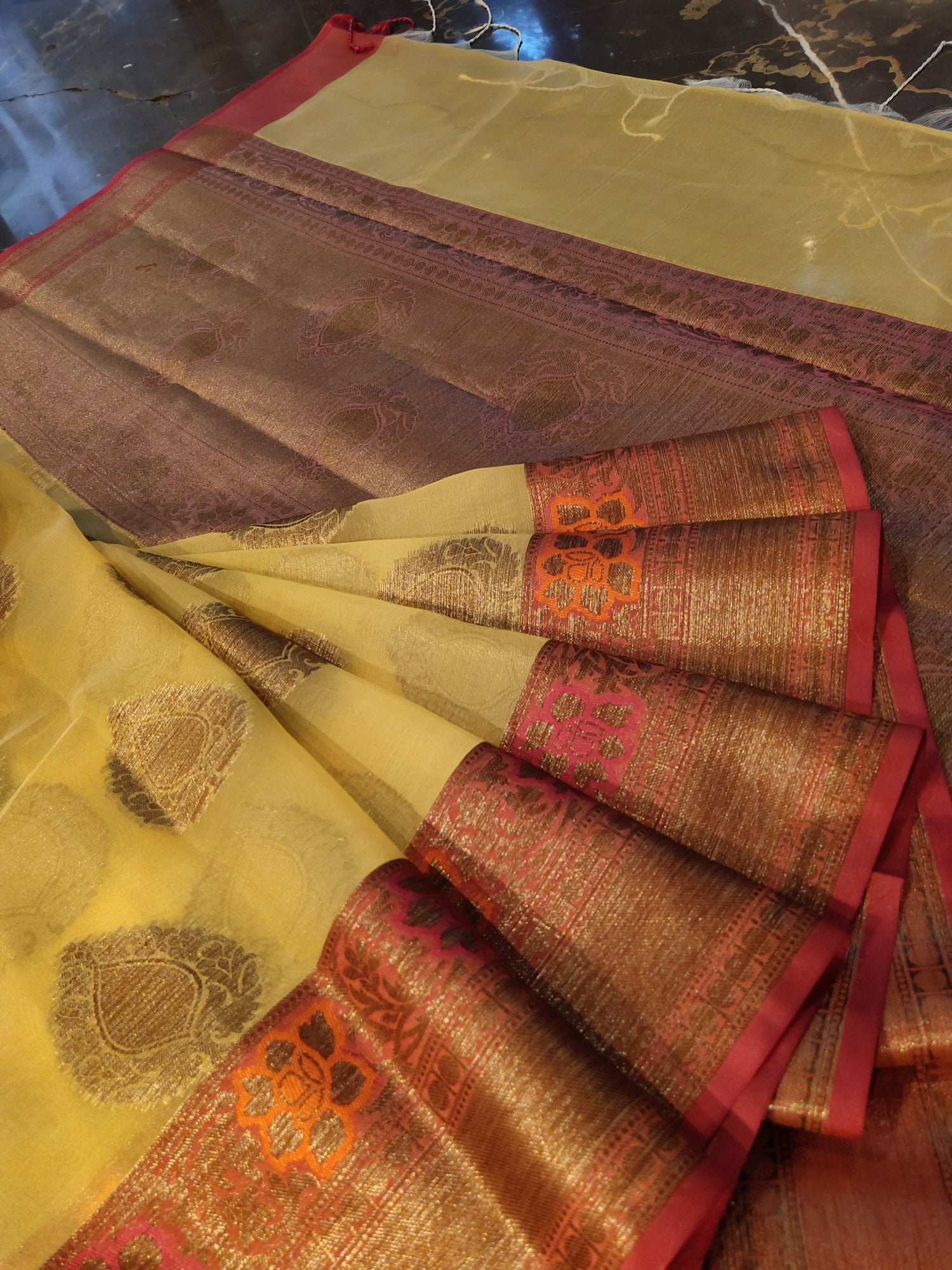 Yellow kora saree with golden zari booties all over