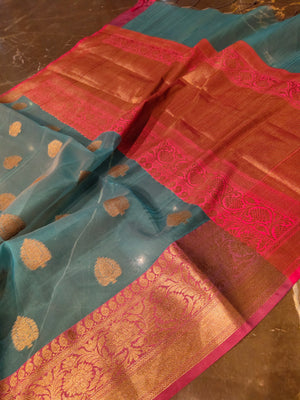 Blue kora silk saree with golden zari booties all over and zari weaving border