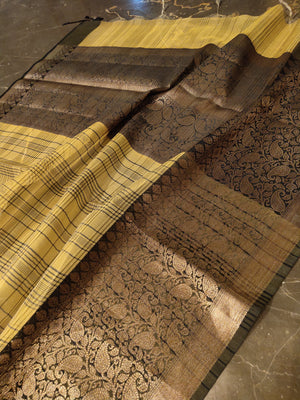 Yellow kora silk saree with broad black checks and black with golden zari border