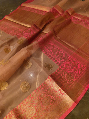 Peach kora saree with all over booties and golden zari weaving border in pink