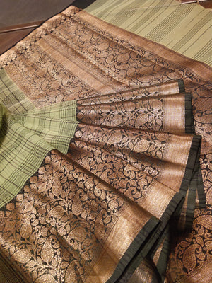 Mint green kora saree with broad checks all over and black with golden zari weaving border