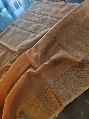Light orange linen saree with golden zari weaving border