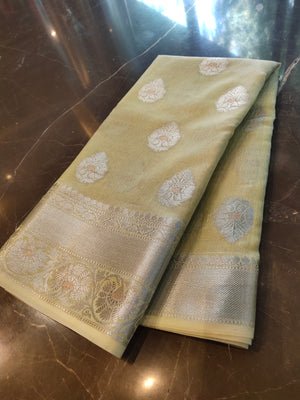 Lemon yellow linen saree with silver all over bootiea and silver weaving border