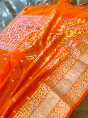 Orange chanderi silk saree with silver booties all over and border