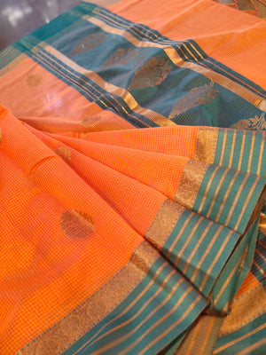 Orange chanderi saree with all over small checks and zari bootties