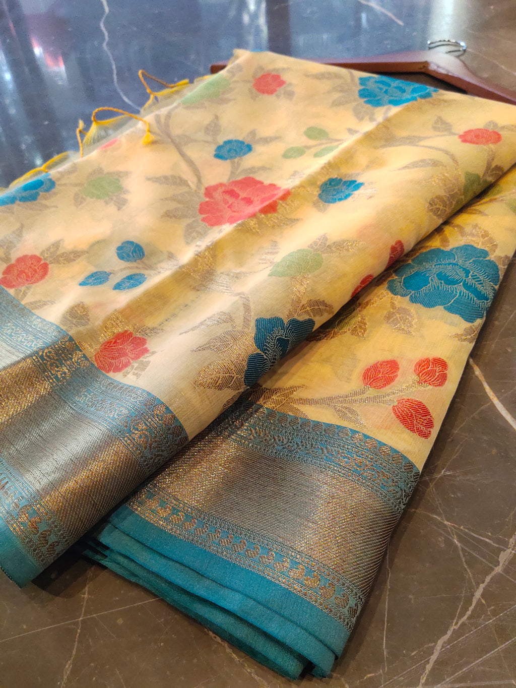 Yellow chanderi saree with all over multi colour jaal and zari weaving border