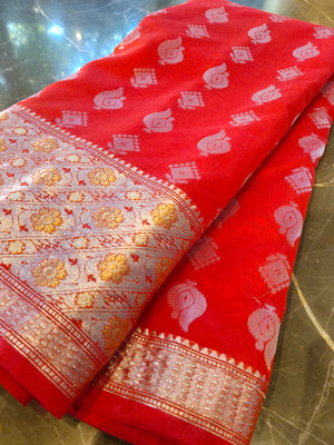 Red chanderi saree with all over silver zari bootties and border