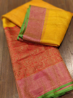 Horizontally divided in yellow and red katan tussar saree with golden zari weaving