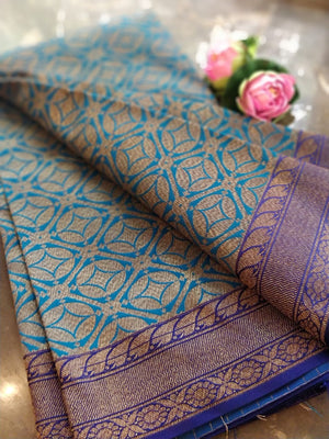 Blue soft silk saree with golden weaving all over and golden zari weaving