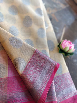 Lemon yellow kota saree with silver zari weaving on pink border and silver booties all over