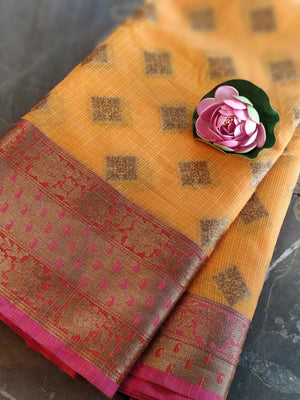 Dark orange kota saree with golden zari weaving on pink border and golden booties all over