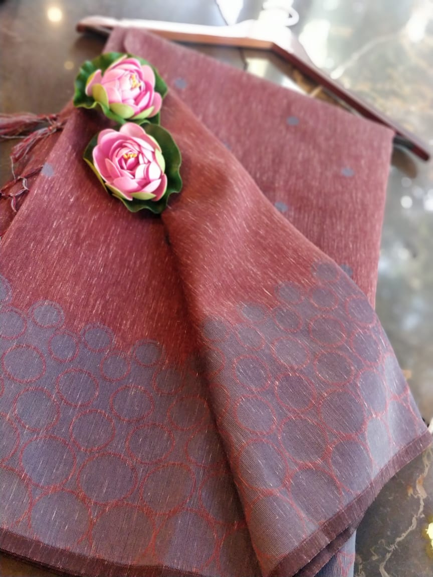 Brown linen saree with silver weaving and booties all over