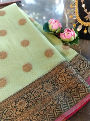 Light parrot green kota saree with golden zari weaving and booties all over