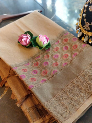 Light beige linen saree with golden zari weaving and Multicolor flowers on the border