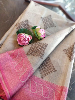Off white linen saree with pink zari weaving
