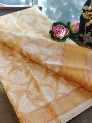 Off white supernet kota saree with yellow jaal overall and yellow border