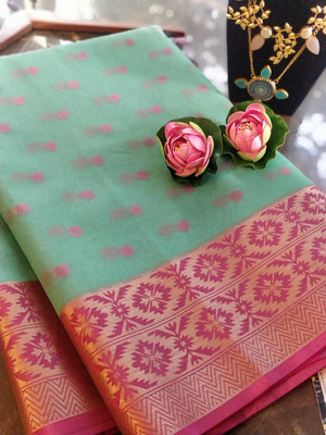 Green kora saree with golden zari weaving border