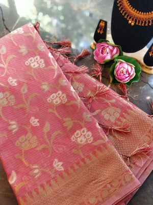 Peach kota saree with all over floral golden zaal