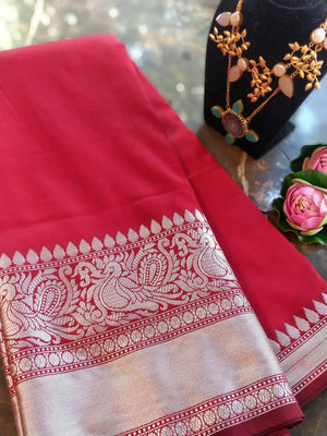 Red plain soft silk saree with silver zari border